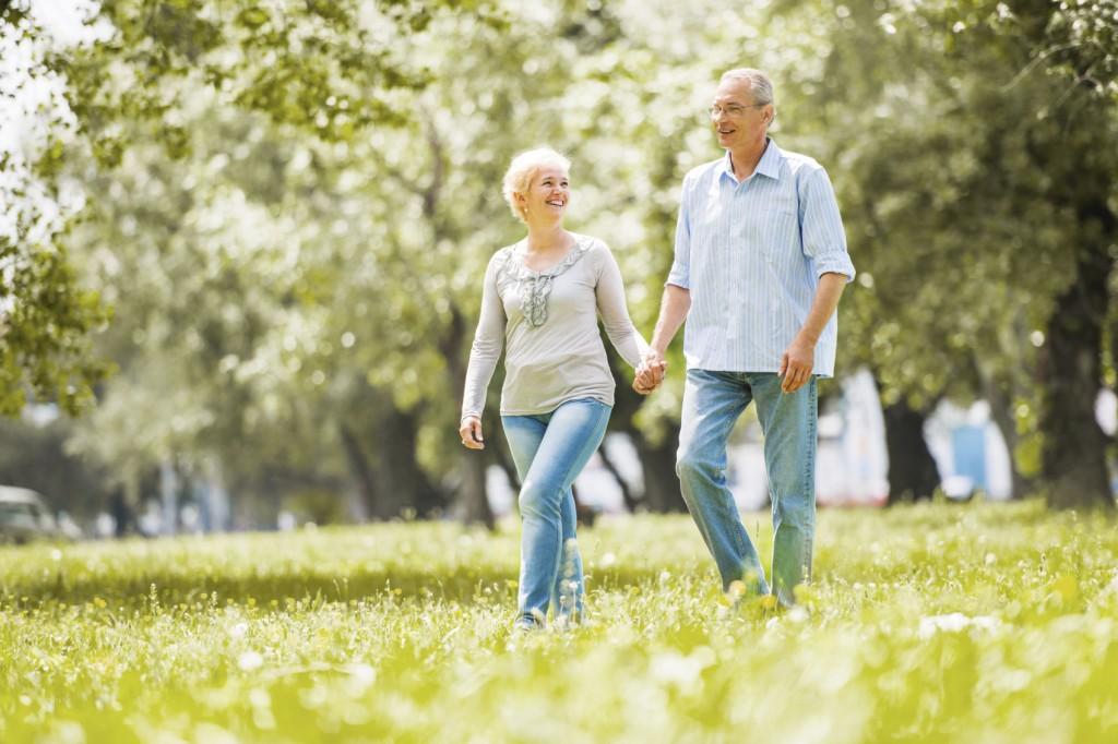 Happy mature couple walking