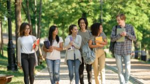 multiethnic-group-of-young-cheerful-students-walking